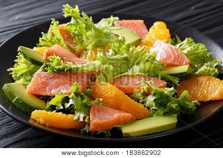 Salad Of Salmon, Oranges, Avocado And Lettuce Frisee Close-up On A Plate. Horizontal
