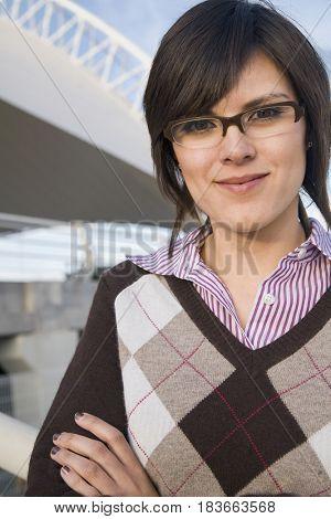 Hispanic woman in eyeglasses smiling
