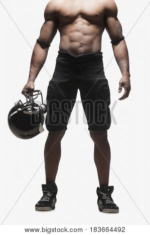 Low section of bare chested football player