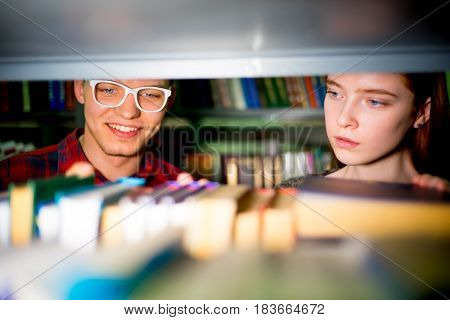 College students reading books in university library