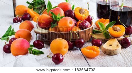 Ceramic Bowl With Organic Ripe Apricots Cherries And Juice