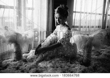 Young Beautiful Bride In Boho Style And White Feathers.