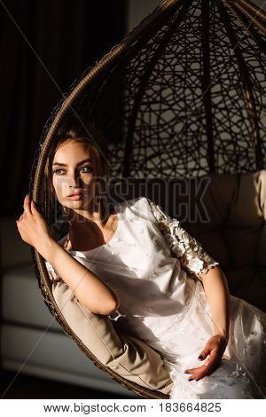 Woman, The Bride Sits On A Wicker Swing. Sunny Summer Day