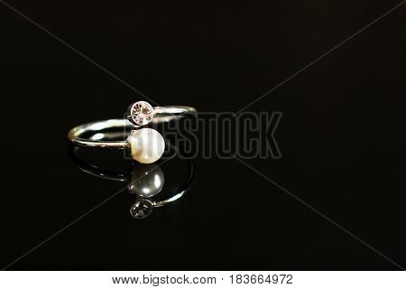 Beautiful wedding rings on a black glossy surface object