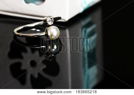 Beautiful Wedding Rings On A Black Glossy Surface