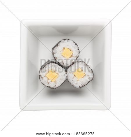 Egg roll hosomaki in a square bowl isolated on white background