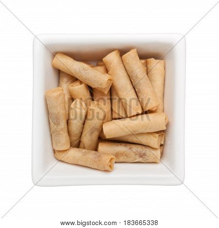 Spicy dried prawn rolls in a square bowl isolated on white background