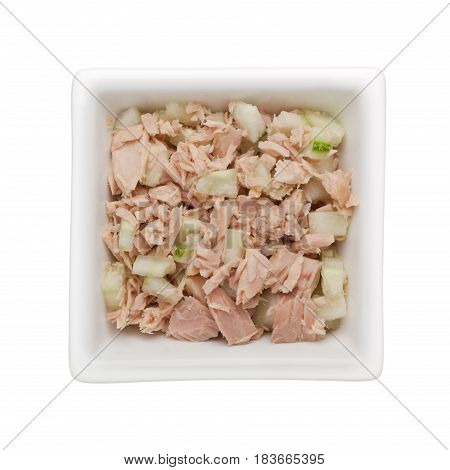 Mixture of tuna and diced cucumber in a square bowl isolated on white background