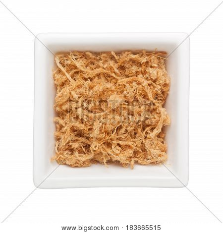 Pork floss in a square bowl isolated on white background