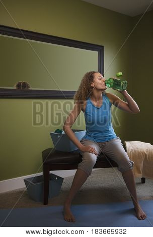African woman drinking water