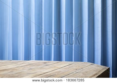Empty table top with office blue blinds for montage your product or ads.