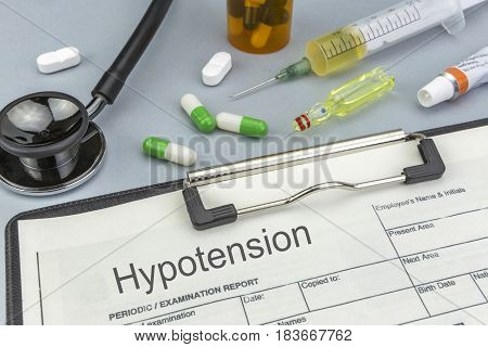 Hypotension medicines and syringes as concept of ordinary treatment health