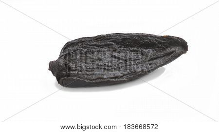 single black organic fermented onion isolated on a white background