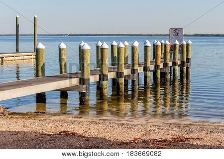 Sports pier with wooden pylons in Tampa Bay Florida