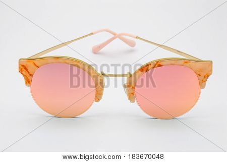 Closeup To Marble Frame With Rose Pink Lens Sunglasses, Isolated