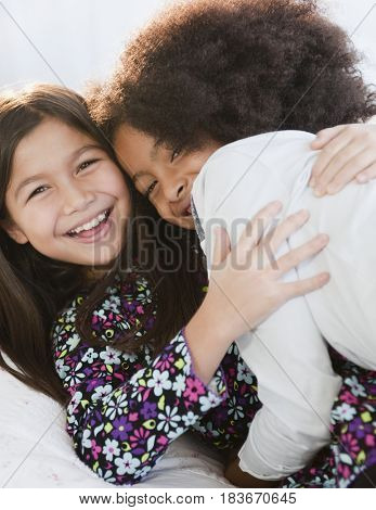 Girls laughing and hugging