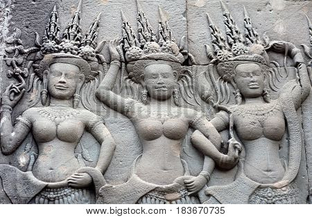 Ancient reliefs with Apsaras at Angkor Wat temple, Cambodia. Angkor Wat was built between 1113 and 1150 by King Suryavarman II.