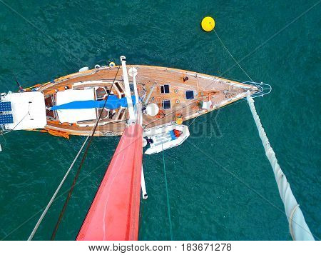 Looking down at the sailboat from the top of the mast