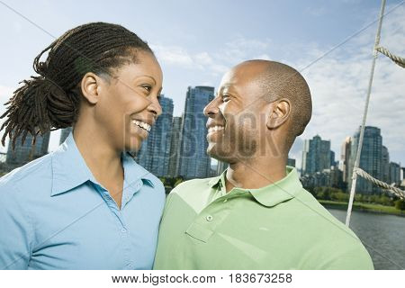 African American woman smiling at boyfriend