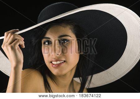 Smiling Hispanic woman in large hat