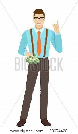 Businessman with cash money pointing up. A man wearing a tie and suspenders. Full length portrait of businessman character in a flat style. Vector illustration.