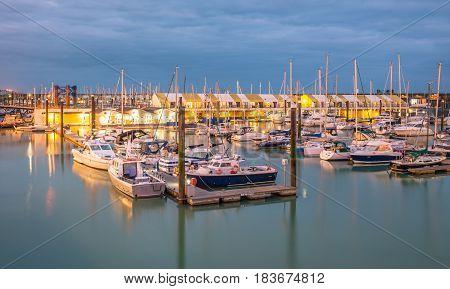 Brighton, England. 13 April 2017. Boats yachts and fishing boats moored at Brighton Marina docs on a cloudy day.