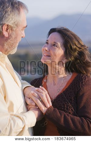 Hispanic couple holding hands