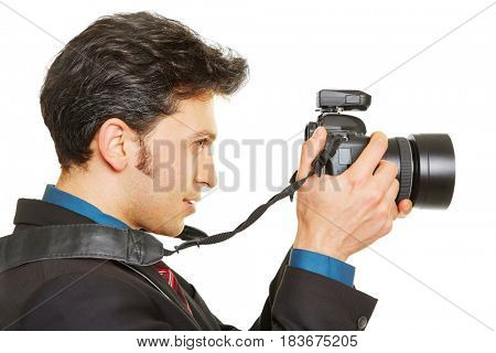 Side view of photographer taking pictures with digital camera