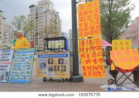 TAIPEI TAIWAN - DECEMBER 6, 2016: Unidentified Falun Gong practitioner protests against Chinese communist party. Falun Gong is a Chinese spiritual practice viewed as a potential threat of China.