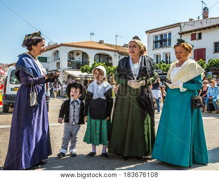 Saint-Marie-de-la-Mer, Provence, France - May 25, 2015. World Festival of Gypsies.  Women and children in fabulously beautiful medieval clothes