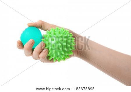 Female hand with stress balls on white background