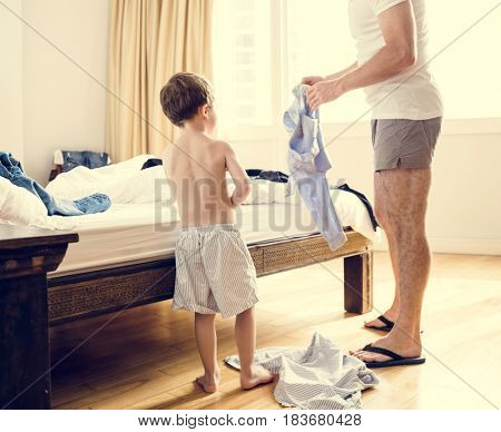 in the Bedroom Son and Dad Put on Clothes Routine Life