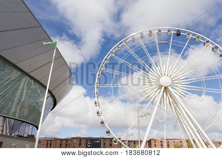Liverpool, England - April 2, 2017 - Echo Arena and the Wheel of Liverpool. Both attractions are located in the Kings Dock