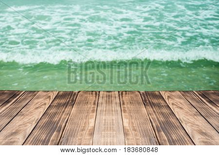 Old wood table top on blurred beach background,Space available for the product