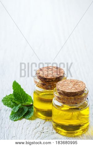 Organic Essential Mint Oil With Green Leaves