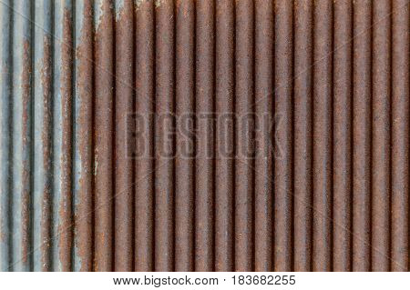 Old rusty texture of corrugated metal. Rusted galvanized iron plate