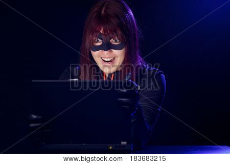 Thief woman in black mask