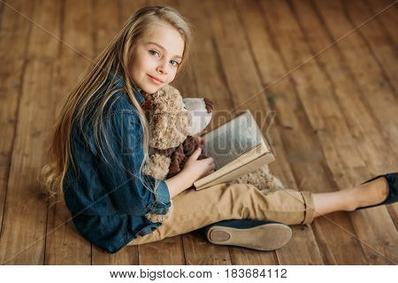 Smiling Little Girl With Teddy Bear Holding Book, Education Kids Concept