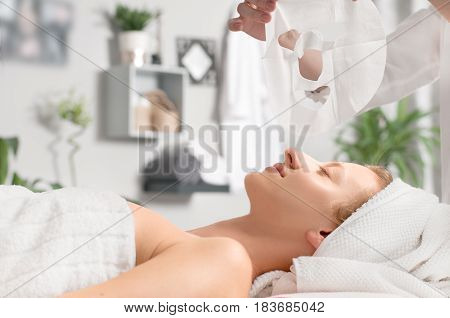 Beautiful Young Woman Is Getting Facial Mask At Spa
