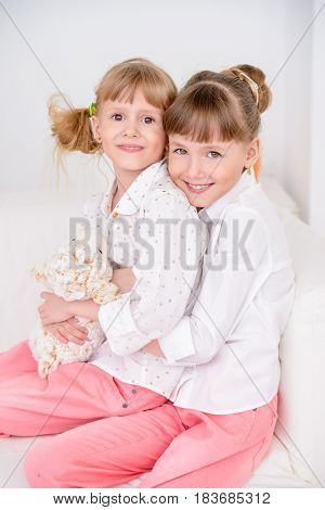 Portrait of two happy little sisters. Loving family concept.