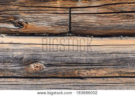wall made of wooden logs. Brown Wooden Debarked Logs