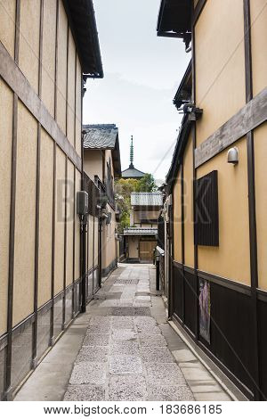 Traditional Street in Kyoto Japan with distant temple spire. Vertical format