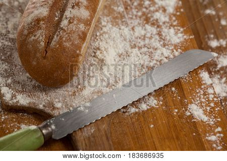 Close-up of sliced bread with knife on cutting board