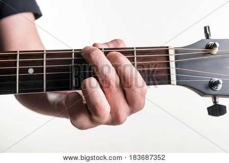 The Guitarist's Hand Clamps The Chord G On The Guitar, On A White Background. Horizontal Frame