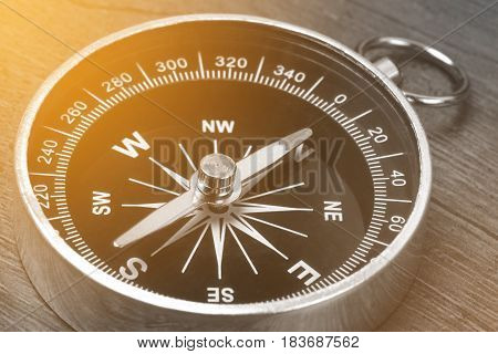 Old vintage retro compass Instrument that indicates magnetic north.