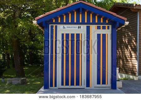 Orange And Blue Toilet For Public Outdoor