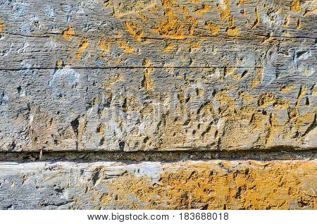 Fragment of the wall of an old wooden house.