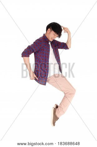 An young Asian man in a checkered shirt and sneakers dancing on his toe isolated for white background.
