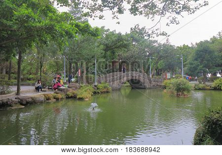 TAIPEI TAIWAN - DECEMBER 7, 2016: Unidentified people visit 228 Peace Park. 228 Peace Park is located in the middle of Taipei downtown.
