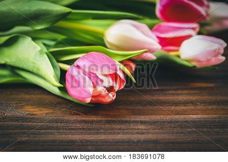 Bouquet Of Pink Tulips On Brown Wooden Background. Top View, Copy Space. Happy Mother's Day.